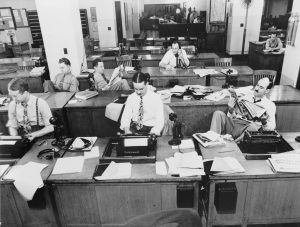 Yesterday's content creators on the job in The New York Times newsroom circa 1942